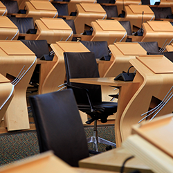 Empty chairs in the Debating Chamber