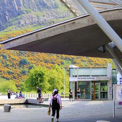 View of the Public Entrance of the Scottish Parliament on Horse Wynd with Salisbury Crags in the background