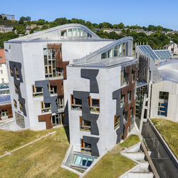 Exterior view of the Scottish Parliament towers on a sunny day